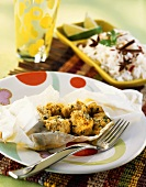 Diced chicken breast with curry & coconut in parchment paper