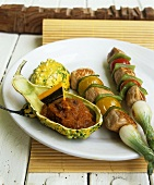Two chicken and vegetable kebabs with pumpkin confit