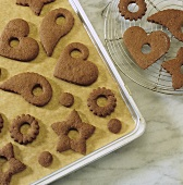 Gingerbread biscuits (to hang on the Xmas tree) on baking tray