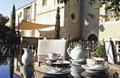 Table on terrace of restaurant 'Oustau de Beaumanière', France