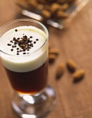 Almond coffee in glass (Coffee with almond syrup & milk froth)