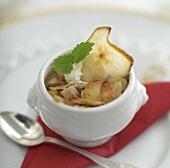 Glazed pear slices with nuts and cream