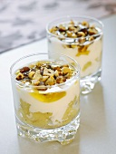 Layered yoghurt and apple dessert with honey and hazelnuts