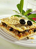 Onion pie with olives and capers