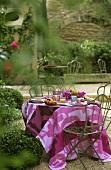 Laid breakfast table in garden