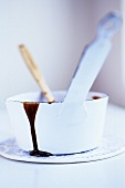 Melted chocolate in white saucepan