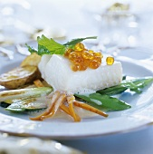 Fish fillet with vegetables and salmon caviar