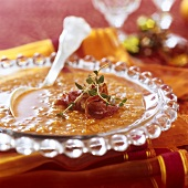 Red lentil soup garnished with schinkenspeck (cured pork) & thyme