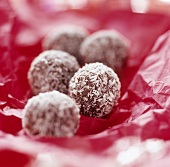 Chocolates coated in grated coconut