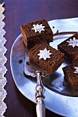 Brownies decorated with icing sugar stars