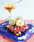 Three scoops of sorbet on watermelon