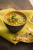 A bowl of curried lentil soup with coriander