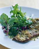Fried beef sirloin with thyme & mustard crust, herb salad