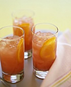 Three glasses of Campari Orange