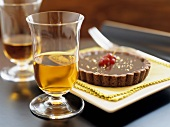 Small chocolate tart beside dessert wine