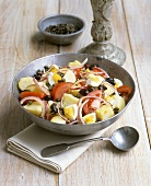 Potato salad with tomatoes, onions, egg, olives and capers