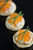 Salmon caviar on blinis