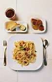 Spaghetti carbonara, white bread with herb butter