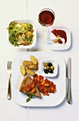 Tuna steak with vegetables, salad, yoghurt with berry puree