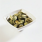 Cardamom pods in a bowl