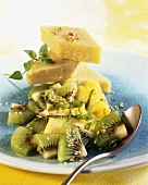 Sweet polenta with kiwi fruit salad