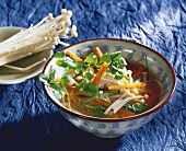Vegetable soup with enoki mushrooms