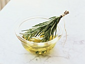 Rosemary oil in small glass bowl