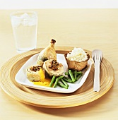 Chicken with mushroom stuffing, beans and rice