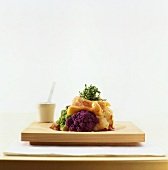 Coloured cauliflower with toasted goat's cheese topping