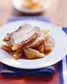 Roast pork with crackling and braised vegetables