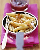 Sweet potato noodles with plums and almond praline