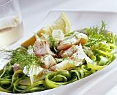Green pasta nest with zander fillet