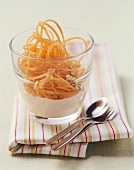 Carrot spaghetti with yoghurt and nuts
