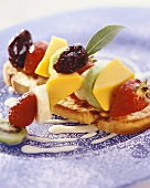 Skewered fruit on toasted white bread