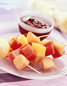 Skewered fruit with chocolate sauce