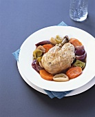 Braised chicken on bed of vegetables
