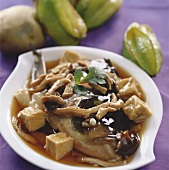 Fish head with tofu, pork and mushrooms