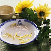 Fish soup with chrysanthemum petals