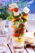 Skewered vegetables in glass
