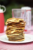 Corn pancakes in a pile on a plate