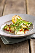 Marinated Halloumi cheese with rocket