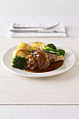 Lamb shank with potatoes and broccoli