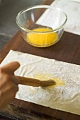 Brushing pastry with melted butter