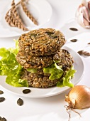 Four spelt burgers in a pile