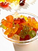 Coloured gummy bears in a small glass bowl