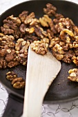 Toasting walnuts in a frying pan