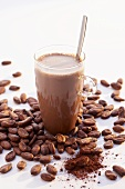 Hot cocoa with spoon and cocoa beans