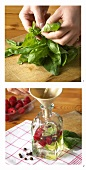 Pouring vinegar into bottle for raspberry and basil vinegar