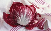 A radicchio on striped tea towel