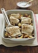 Seebarsch auf Kartoffel, Knoblauch & Oliven